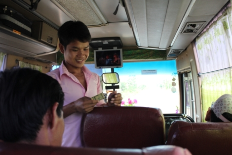 Assistant driver collecting money from additional passengers, or what we call hop-ons