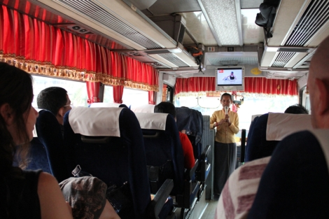 Bus attendant telling us about what to expect