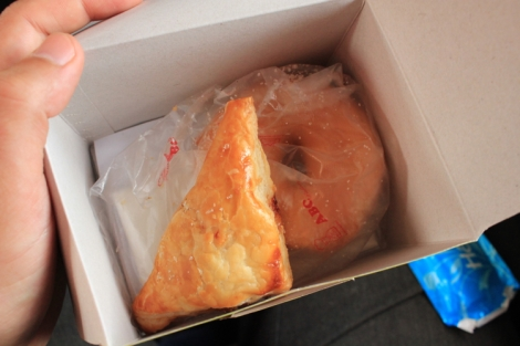 Light snack of donut and pork turnover
