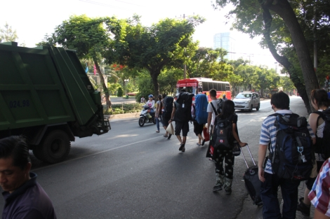 Bunch of backpackers walking towards the bus