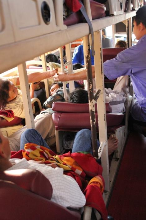 Notice the guy sleeping in the space between bunks