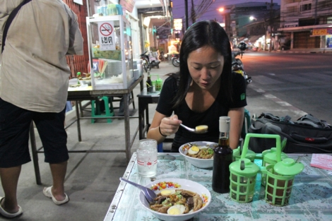 Julie enjoying her soup at the street side place we found