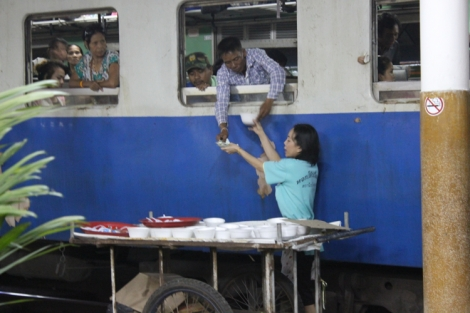 That's how people on the train get fed during the stops. This lady was super quick and franticly tried to serve the entire length of the massive train in the time it was in the station.
