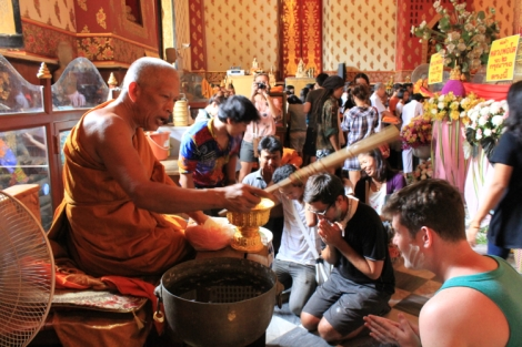 """Adam and Corey get some blessings """"good luck, good luck, happy, happy!"""" says the monk (literally)"""