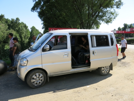 This is what a minibus looks like. The location of the photo is not the Miyun Bus Terminus however.